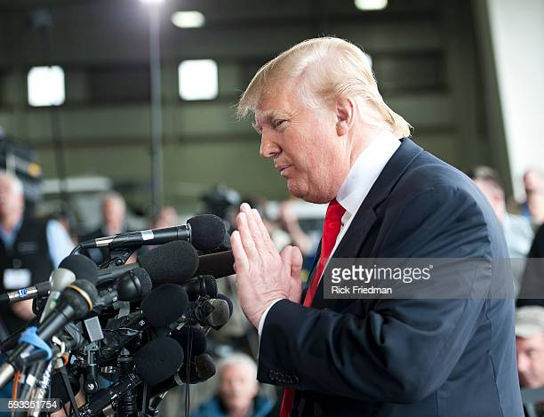 Donald Trump talking with the media after arriving by helicopter at Pease International Tradeport in Portsmouth NH on April 27 2011