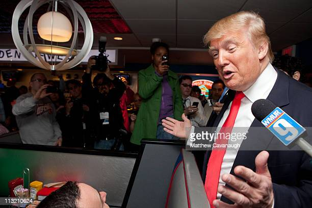 Donald Trump talks to customers at the Roundabout Diner on April 27 2011 in Portsmouth New Hampshire Trump is testing the waters for a possible run...