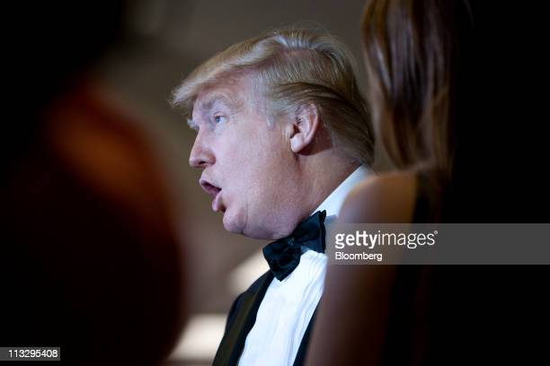 Donald Trump talks with other guests at the White House Correspondents' Association dinner in Washington DC US on Saturday Aprill 30 2011 The dinner...
