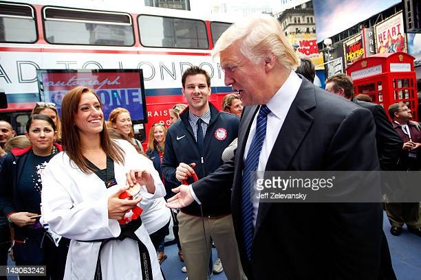 Donald Trump talks with taekwando athlete Diana Lopez and fencer Tim Morehouse during the Team USA Road to London 100 Days Out Celebration in Times...