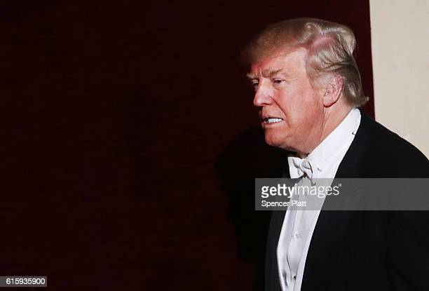 Donald Trump walks onto the stage while attending the annual Alfred E Smith Memorial Foundation Dinner at the Waldorf Astoria on October 20 2016 in...