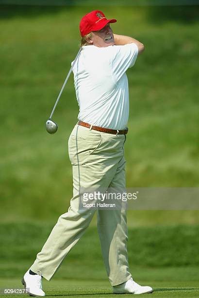 Donald Trump walks up the ninth fairway during the pro-am prior to the start of the Buick Classic at the Westchester Country Club on June 9, 2004 in...