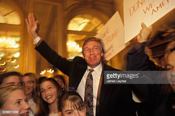 Donald Trump waving to supporters at the Plaza Hotel after a New York Post article talks of his plans to sell the Plaza to the Sultan of Brunei