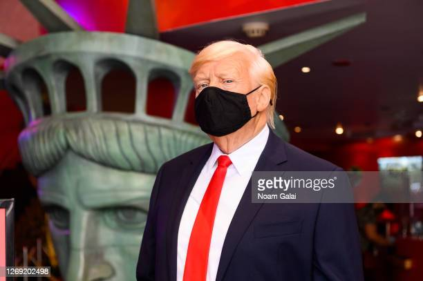 Donald Trump wax figure wearing a protective face mask is displayed as Madame Tussauds New York re-opens to the public during Phase 4 of re-opening...
