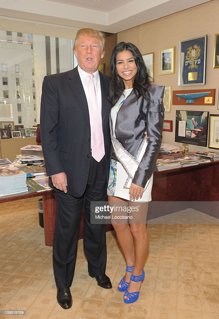 Donald Trump welcomes Miss USA 2010 Rima Fakih to his office in Trump Tower on May 20, 2010 in New York City.