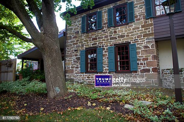 Donald Trump yard sign is displayed outside a residence October 22 2016 in Abbottstown Pennsylvania Trump delivered a policy speech in nearby...