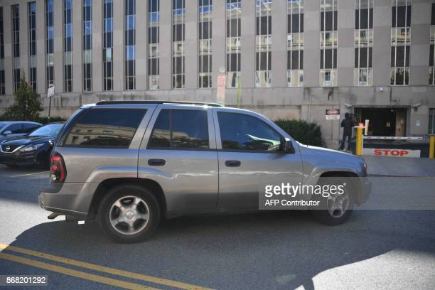 Donald Trump's former campaign chairman Paul Manafort arrives in an SUV at the US Federal Court House on October 30 2017 in WashingtonDC Paul...