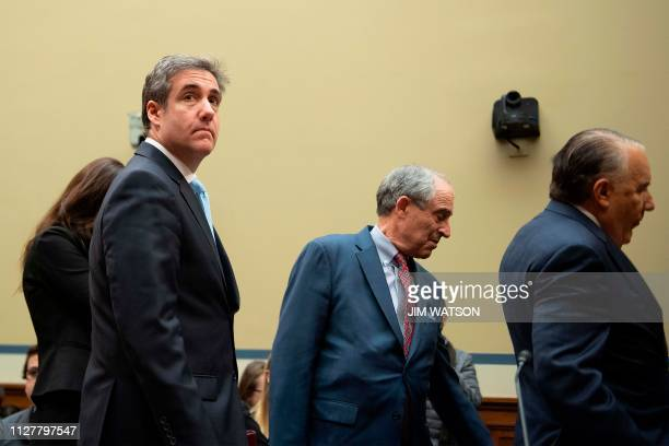Donald Trump's former personal attorney Michael Cohen and his legal team arrive to testify before the House Oversight and Reform Committee in the...