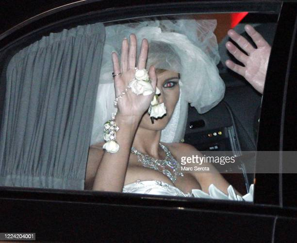 Donald Trump's new bride Slovenian model Melanai Knauss waves as she leaves the BethesdabytheSea Episcopal Church after her wedding to Donald in Palm...