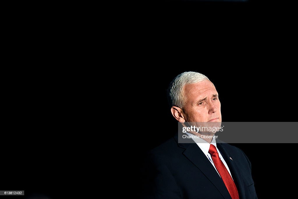 Donald Trump's running mate, Indiana Gov. Mike Pence, promised to renegotiate the North American Free Trade Agreement and other trade deals that Trump says hurt American workers during a campaign rally on Monday, Oct. 10, 2016 in Charlotte, N.C.