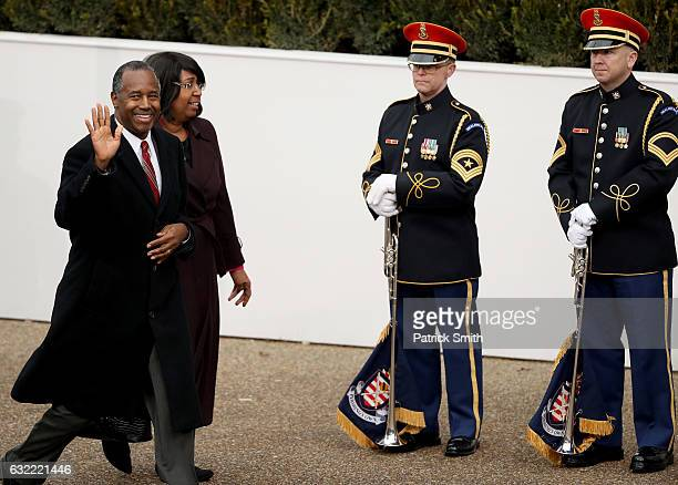 Donald Trump's Secretary of Housing and Urban Development Ben Carson and his wife Candy Carson arrive at the main reviewing stand in front of the...