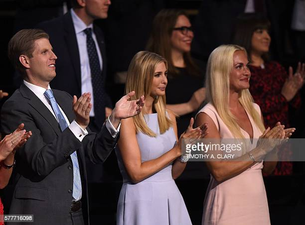 Donald Trump's son Eric and his wife Vanessa and daughter Ivanka clap on the second day of the Republican National Convention on July 19 2016 at...