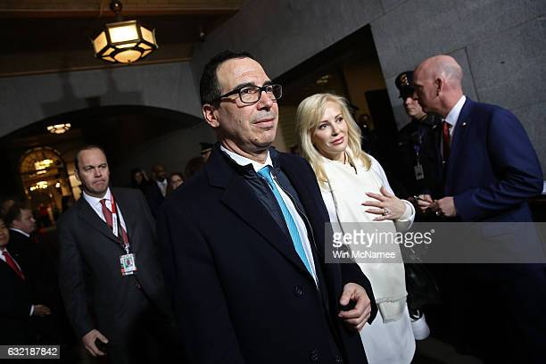 Donald Trumps' Treasury Secretary Steven Mnuchin arrives on the West Front of the US Capitol on January 20 2017 in Washington DC In today's...