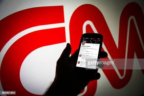 Donald Trump's Twitter timeline is seen on a smartphone against a backdrop with the CNN logo in this photo illustration on 2 July 2017 Donald Trump...