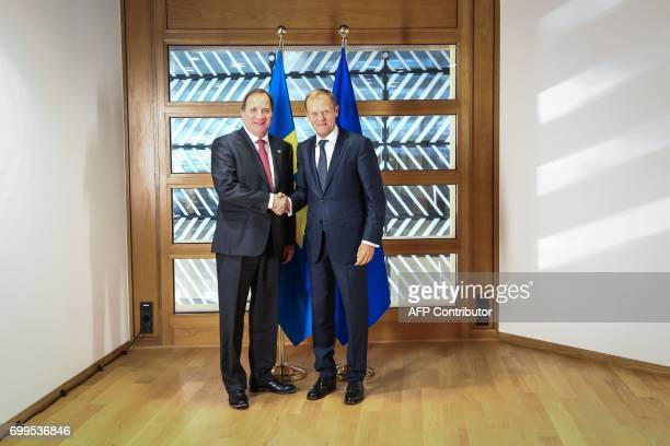 Donald Tusk President of the EU Council shakes hands with Stefan Lofven Swedish Prime Minister prior to the EU Summit in Brussels on June 22 2017 /...