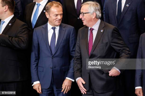 Donald Tusk president of the European Union left and JeanClaude Juncker president of the European Commission take their positions during a family...