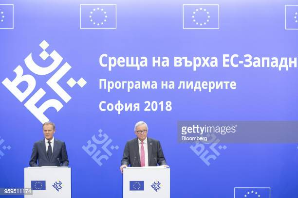 Donald Tusk president of the European Union left speaks beside JeanClaude Juncker president of the European Commission during a news conference at a...