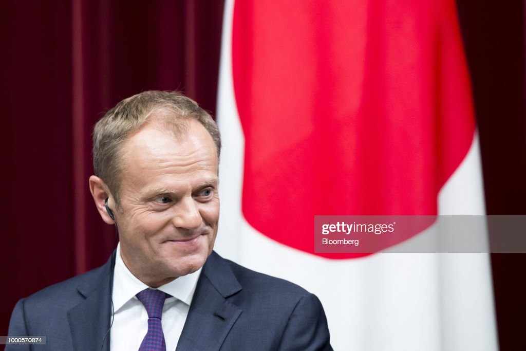 Donald Tusk, president of the European Union (EU), listens during a joint news conference with Shinzo Abe, Japan's prime minister, and Jean-Claude Juncker, president of the European Commission, following a summit at the prime minister's official residence in Tokyo, Japan, on Tuesday, July 17, 2018. Japan and the EU signed a trade agreement on Tuesday in Tokyo that lowers barriers on the movement of goods and services between the two economies and provides a counterweight to U.S. protectionism. Photographer: Tomohiro Ohsumi/Bloomberg via Getty Images