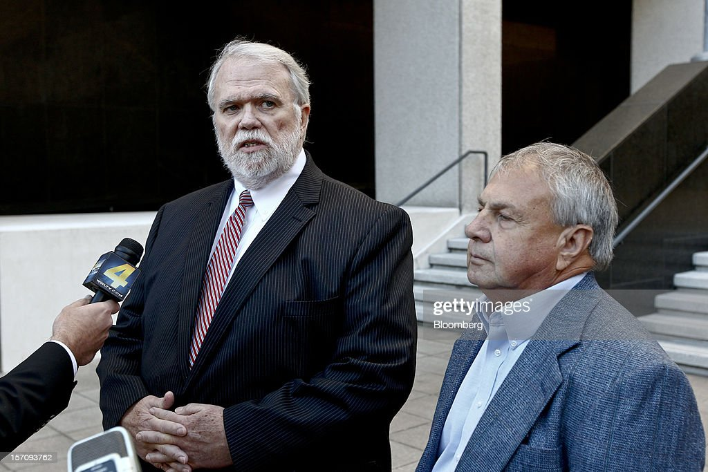 Donald Vidrine, a well site manager for BP Plc during the 2010 explosion on board the Deepwater Horizon oil rig, right, listens as his attorney Robert Habans, speaks to the media outside federal court in New Orleans, Louisiana, U.S., on Wednesday, Nov. 28, 2012. Vidrine and another site manager Robert Kaluza, were charged Nov. 15 with involuntary manslaughter, seaman's manslaughter and Clean Water Act Violations. The U.S. alleges that Kaluza and Vidrine ignored multiple indications that the well wasn't secure before the explosion that killed 11 aboard the drilling rig. Photographer: Derick E. Hingle/Bloomberg via Getty Images