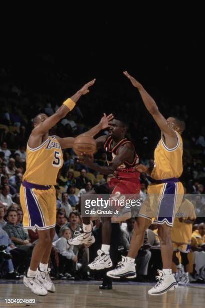 Donald Whiteside, Point Guard for the Atlanta Hawks gets blocked by Robert Horry and Derek Fisher of the Los Angeles Lakers during their NBA Pre...