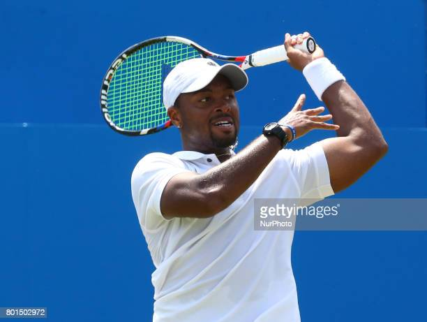 Donald Young against Viktor Troicki SRB during Round Two match on the third day of the ATP Aegon Championships at the Queen's Club in west London on...