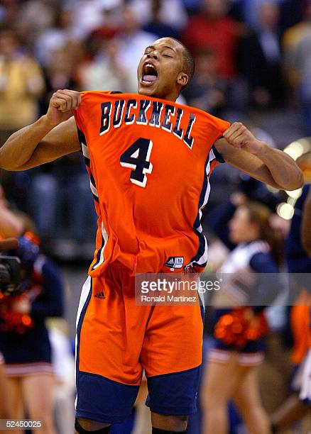 Donald Young of the Bucknell Bison screams as his team upset the Kansas Jayhawks during the first round of the NCAA Men's Basketball Championship on...