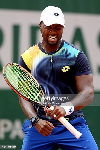 Donald Young of the United States celebrates victory in his men's singles match against Feliciano Lopez of Spain on day five of the French Open at...