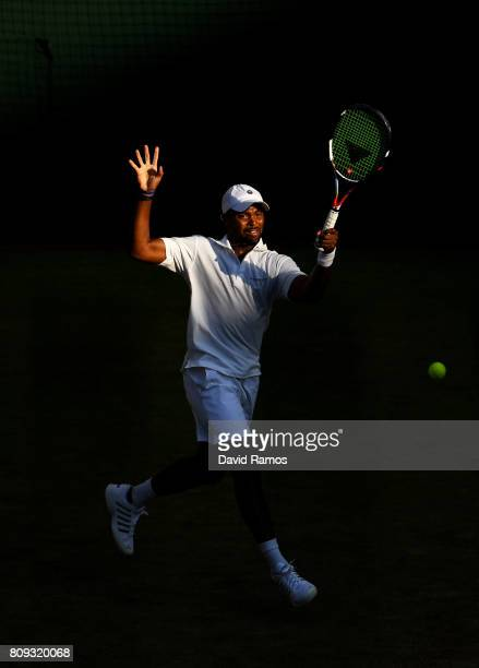 Donald Young of The United States plays a forehand during the Gentlemen's Singles second round match against Rafael Nadal of Spain on day three of...