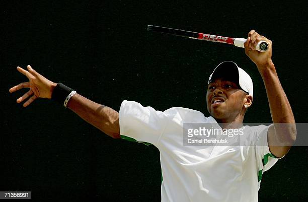 Donald Young of the United States returns a shot to Iain Atkinson of Great Britain during day seven of the Wimbledon Lawn Tennis Championships at the...