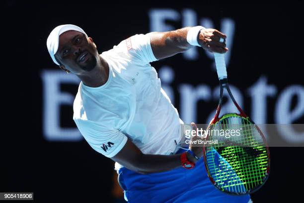 Donald Young of the United States serves in his first round match against Novak Djokovic of Serbia on day two of the 2018 Australian Open at...