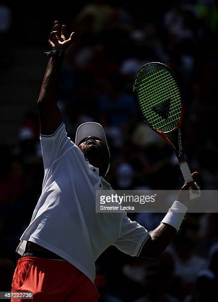 Donald Young of the United States serves to Stan Wawrinka of Switzerland during their Men's Singles Fourth Round match on Day Eight of the 2015 US...