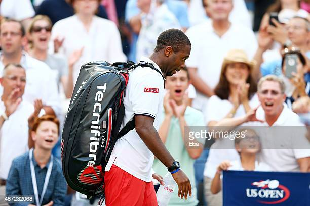 Donald Young of the United States walks off of the court after loosing to Stan Wawrinka of Switzerland during their Men's Singles Fourth Round match...