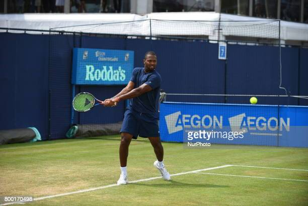 Donald Young of the US practices at The Queen's Club London on June 22 2017 The players use the grass courts to train themselves before the start of...