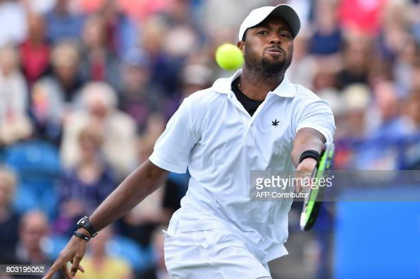 Donald Young of the US returns to Serbian tennis player and world number four Novak Djokovic during their men's singles quarter final tennis match at...