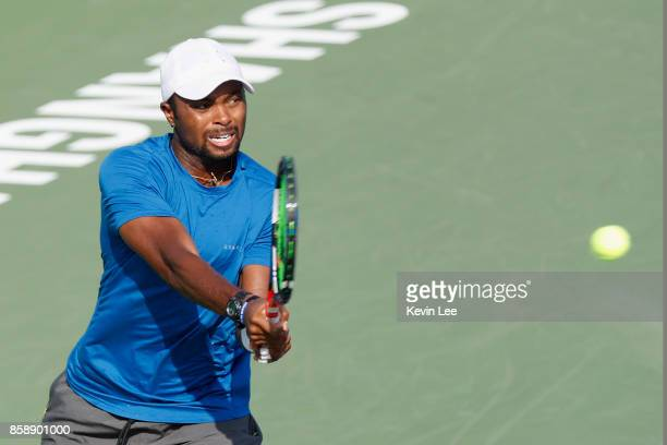 Donald Young of United States returns a shot to Dusan Lajovic of Serbia during Qualifying's Final Round on Day 1 of 2017 ATP 1000 Shanghai Rolex...