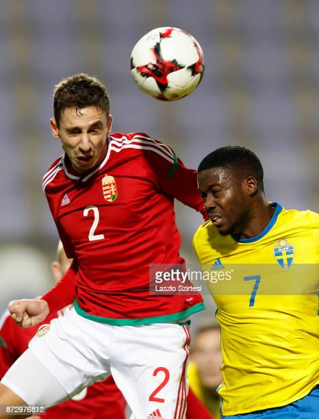 Donat Szivacski of Hungary U21 battles for the ball in the air with Isak Ssewankambo of Sweden U21 during the UEFA Under 21 Euro 2019 Qualifier match...