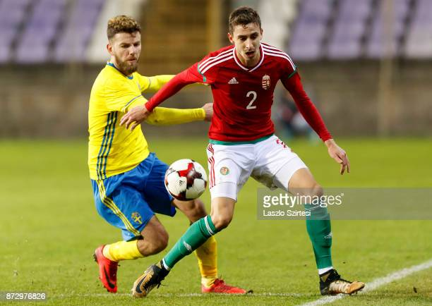 Donat Szivacski of Hungary U21 competes for the ball with Erdal Rakip of Sweden U21 during the UEFA Under 21 Euro 2019 Qualifier match between...