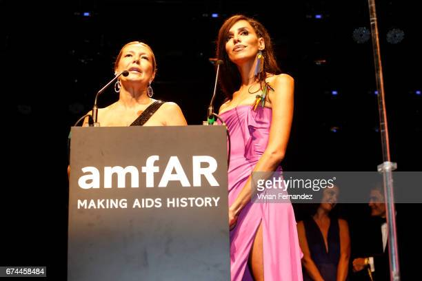 Donata Meirelles and Lea T speak onstage during the 7th Annual amfAR Inspiration Gala on April 27 2017 in Sao Paulo Brazil