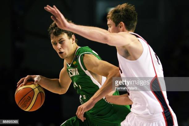 Donatas Motiejunas of Lithuania tries to get past Gordon Hayward of the United States defends during the U19 Basketball World Championships match...