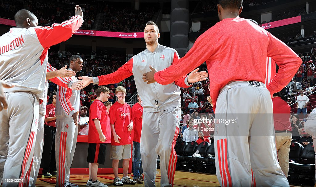 Donatas Motiejunas #20 of the Houston Rockets is announced before the game against the New Orleans Pelicans before the 2013 NBA pre-season game on October 5, 2013 at the Toyota Center in Houston, Texas.