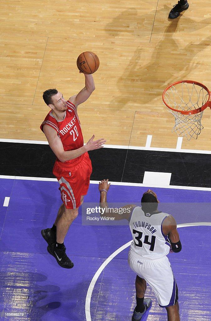 Donatas Motiejunas #20 of the Houston Rockets shoots against Jason Thompson #34 of the Sacramento Kings on April 3, 2013 at Sleep Train Arena in Sacramento, California.