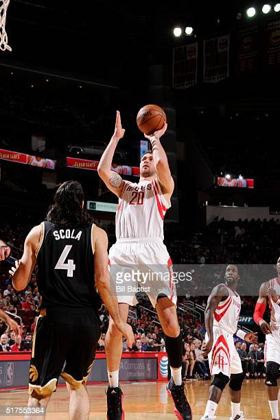 Donatas Motiejunas of the Houston Rockets shoots the ball against the Toronto Raptors on March 25 2016 at the Toyota Center in Houston Texas NOTE TO...