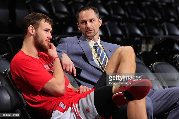 Donatas Motiejunas of the Houston Rockets talks Denver Nuggets Assistant General Manager Arturas Karnisovas prior to their game at Pepsi Center on...