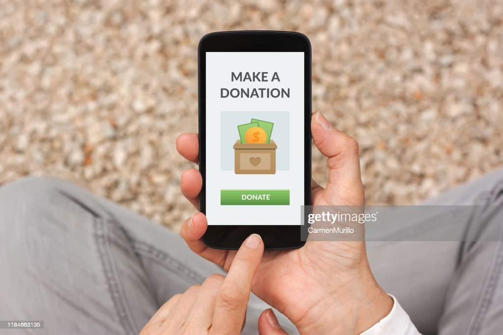 Donate concept on smartphone : Stock Photo