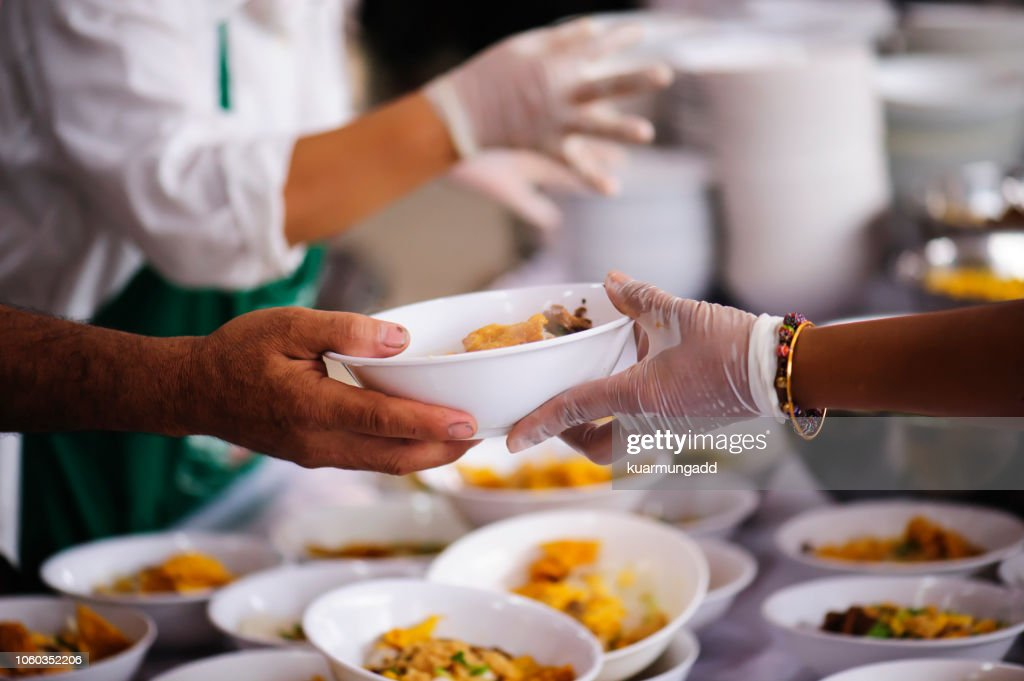 Donate food to hungry people, Concept of poverty and hunger : Stock Photo