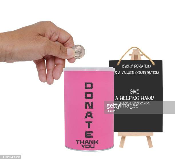 hand holding quarter over donation container