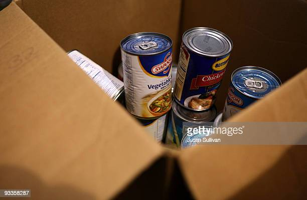 Donated canned food sits in a box at the Alameda Food Bank November 24 2009 in Alameda California Hundreds of needy people lined up for hours to...