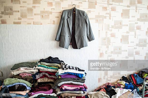 Donated clothes are folded and stacked at a sports school where about 60 people displaced by fighting in Eastern Ukraine live on October 11 2014 in...