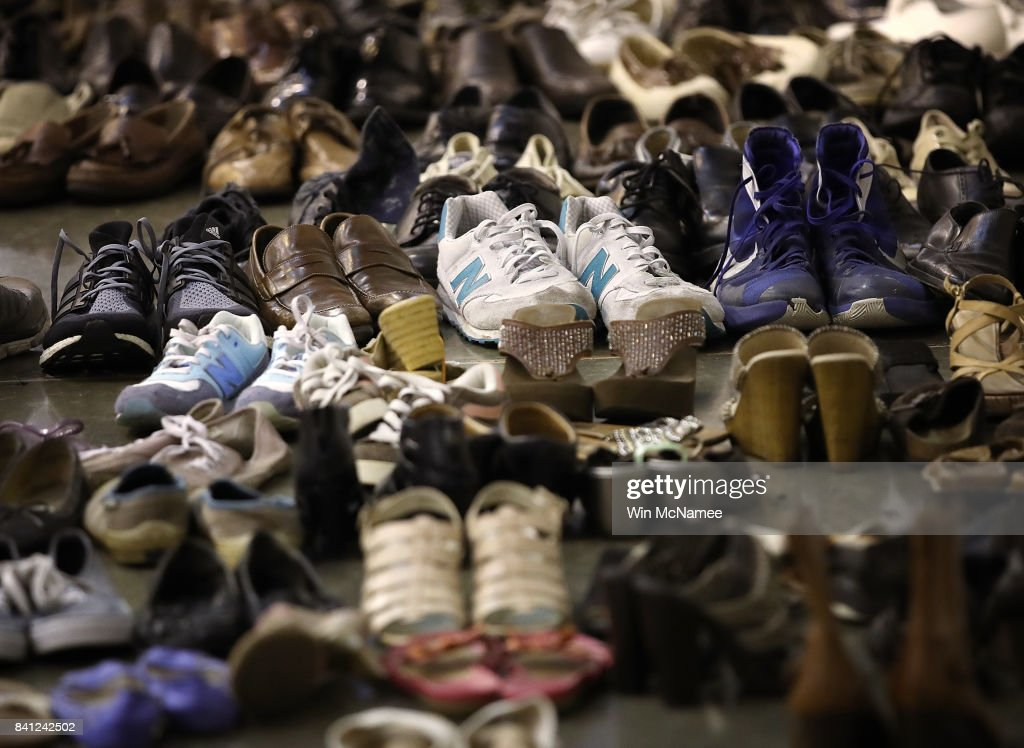 Donated shoes for evacuees forced from their homes due to flooding are shown at the NRG Center August 31, 2017 in Houston, Texas. Thousands of Houston area residents are living in temporary shelters as the city of Houston is still experiencing severe flooding in some areas due to the accumulation of historic levels of rainfall, though floodwaters are beginning to recede in many parts of the city.