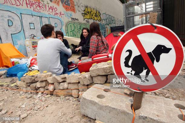 A donated sign tells visitors not to let their dogs defecate on the performance art piece 'Deliverance' in the afternoon on August 8 2012 in Berlin...